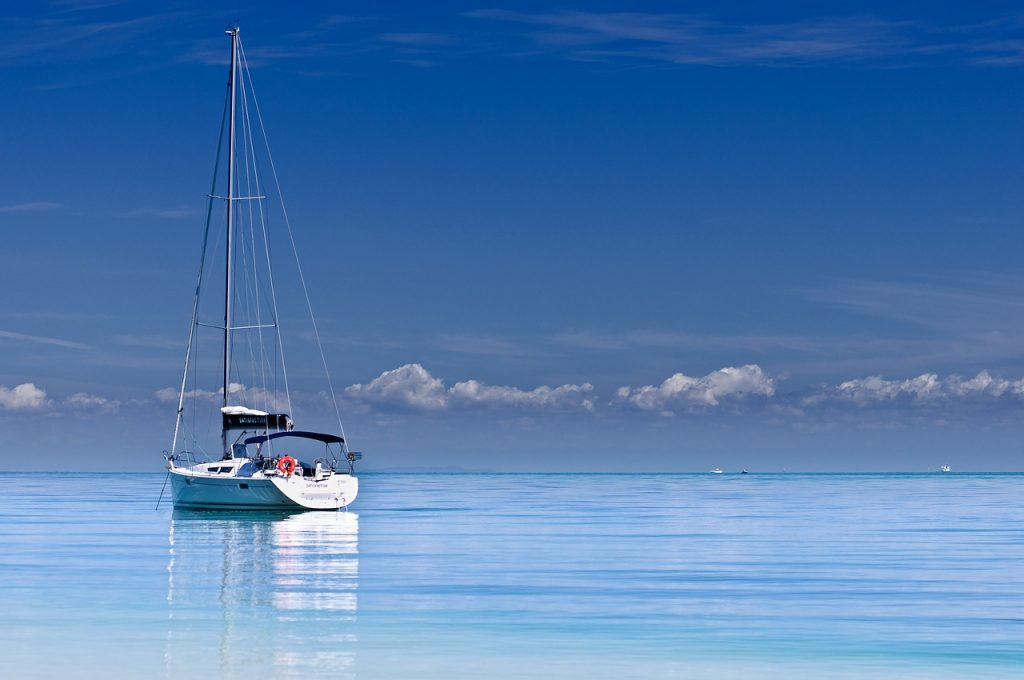 Boat on the ocean on a cloudless blue sky day