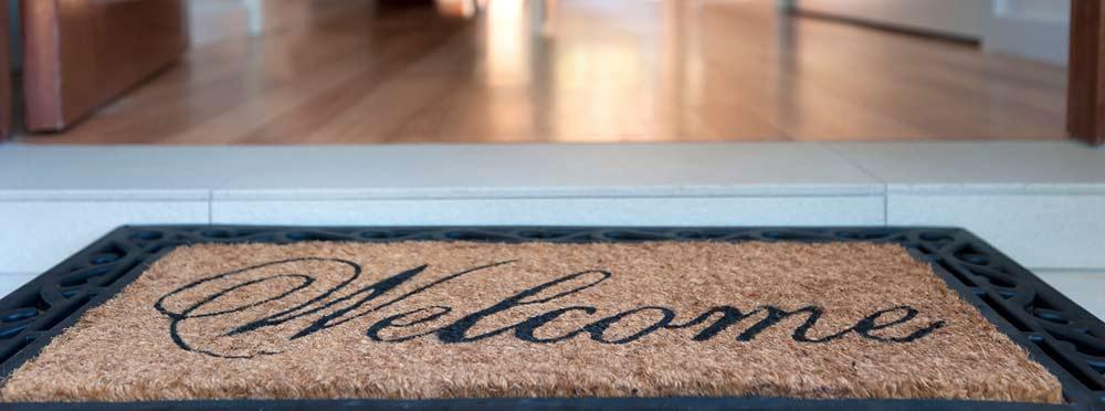 welcome mat with an open door