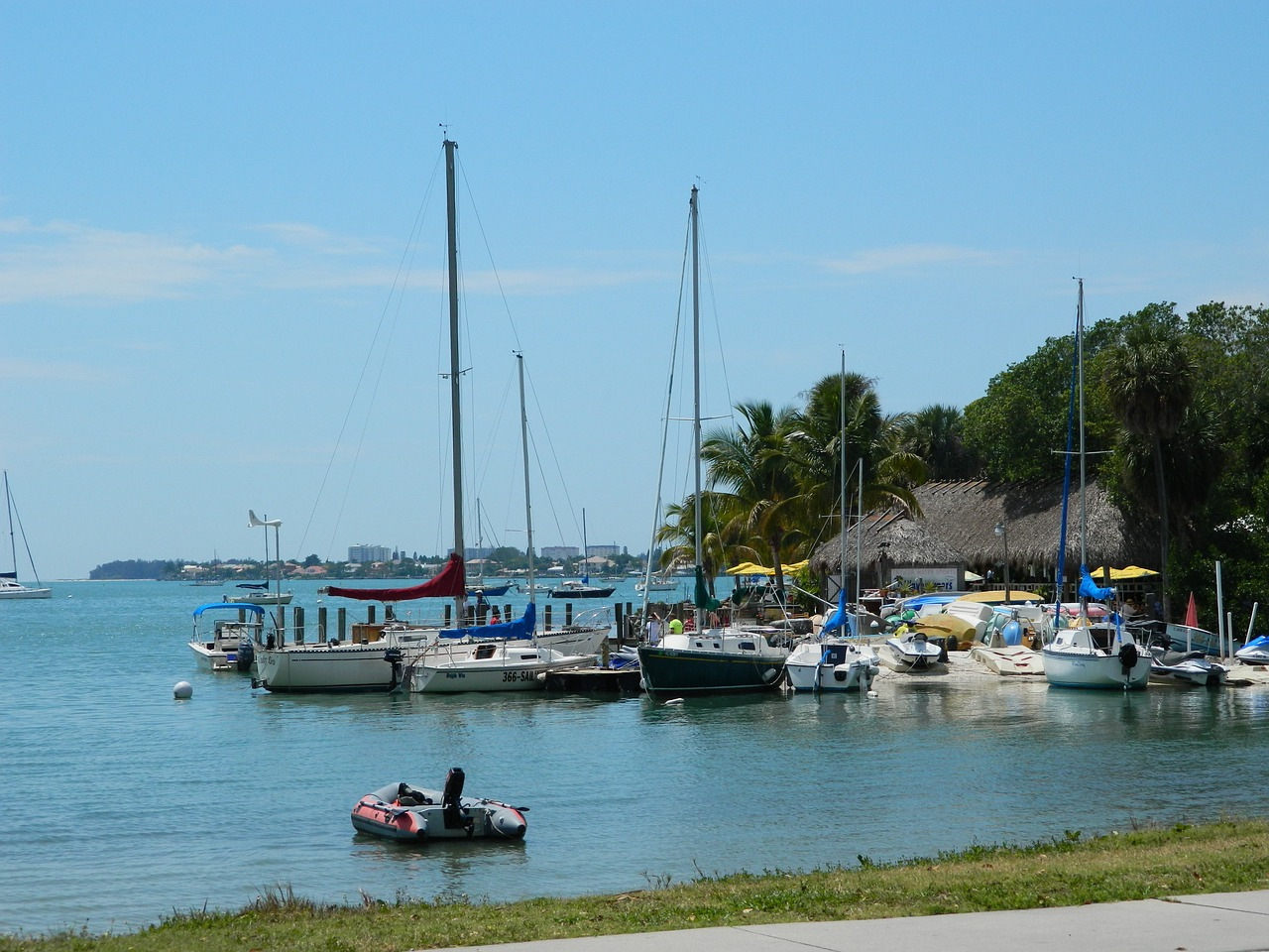 boats near a dock and tiki bar